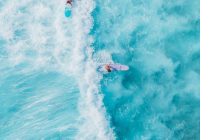 person surfing on blue ocean water