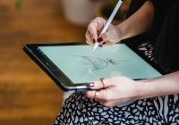 woman drawing sketch on graphic tablet